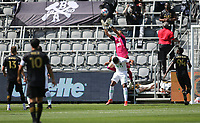 LOS ANGELES, CA - APRIL 17: Pablo Sisniega #23 of LAFC leaps high over Pablo Sisniega #23, Danny Hoesen #9 of Austin FC during a game between Austin FC and Los Angeles FC at Banc of California Stadium on April 17, 2021 in Los Angeles, California.