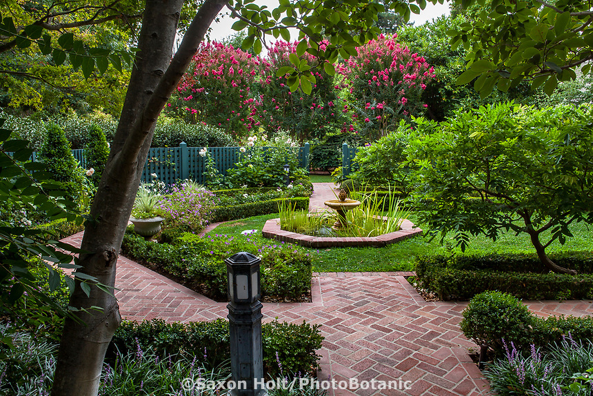 Brick path into the Wisteria Garden room with fountain; Gamble Garden, Palo Alto, California