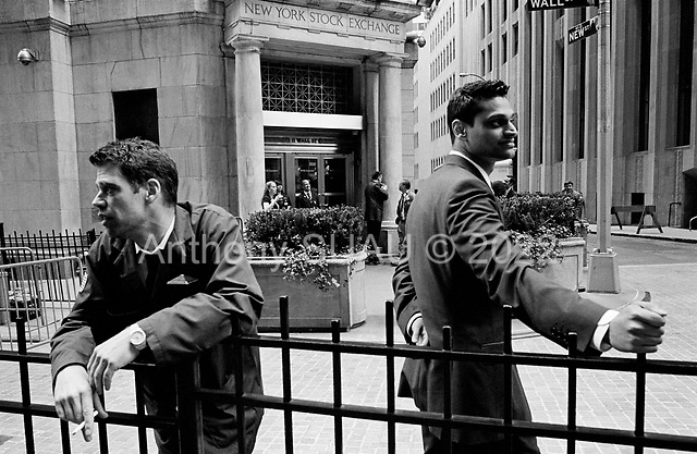 New York, New York<br /> USA<br /> May 2010<br /> <br /> Wall Street traders, investment bankers, musicians, preachers, policemen, security guards, military personal and tourists all make Wall Street and the New York Stock exchange an ever changing three-ring circus were the world of finance and trade come together within a few blocks.<br /> <br /> Traders outside the New York Stock Exchange.