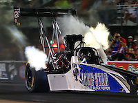 Jun 17, 2016; Bristol, TN, USA; NHRA top fuel driver Terry Haddock loses a fuel line prior to an engine fire during qualifying for the Thunder Valley Nationals at Bristol Dragway. Mandatory Credit: Mark J. Rebilas-USA TODAY Sports