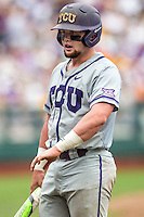 TCU Horned Frogs catcher Evan Skoug (9) shows the umpire where he was hit with a pitched ball against the LSU Tigers in the NCAA College World Series on June 14, 2015 at TD Ameritrade Park in Omaha, Nebraska. TCU defeated LSU 10-3. (Andrew Woolley/Four Seam Images)
