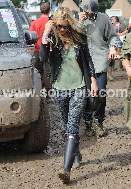 **ALL ROUND PICTURES FROM SOLARPIX.COM**                                             **WORLDWIDE SYNDICATION RIGHTS**                                                                                  Caption:  Kate Moss and Jaime Winstone arrive at The Glastonbury Festival of Contemporary Performing Arts to watch the Kills on stage on Saturday 25 June 2011                                                                             This pic: Kate Moss                                                                                             JOB REF: 13615       LNJ       DATE:                                                            **MUST CREDIT SOLARPIX.COM OR DOUBLE FEE WILL BE CHARGED**                                                                      **MUST AGREE FEE BEFORE ONLINE USAGE**                               **CALL US ON: +34 952 811 768 or LOW RATE FROM UK 0844 617 7637**