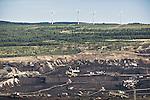 A coal mine in Northwesten Czech Republic and in the background, 4 wind turbines.