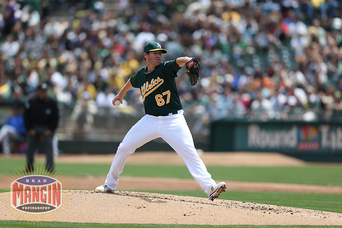 OAKLAND, CA - MAY 15:  Dan Straily #67 of the Oakland Athletics pitches against the Texas Rangers during the game at O.co Coliseum on Wednesday May 15, 2013 in Oakland, California. Photo by Brad Mangin
