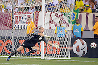 United States goalkeeper Brad Guzan (18) dives for a ball. The men's national team of Brazil (BRA) defeated the United States (USA) 2-0 during an international friendly at the New Meadowlands Stadium in East Rutherford, NJ, on August 10, 2010.