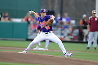 Clemson Tigers starting pitcher Jake Long #39 delivers a pitch during a game against the Florida State Seminoles at Doug Kingsmore Stadium on March 22, 2014 in Clemson, South Carolina. The Seminoles defeated the Tigers 4-3. (Tony Farlow/Four Seam Images)