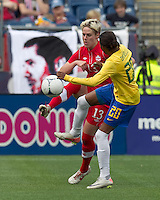 Canadian midfielder Sophie Schmidt (13) and Brazilian player Danilelle Silva (20) battle for the ball. In an international friendly, Canada defeated Brasil, 2-1, at Gillette Stadium on March 24, 2012.