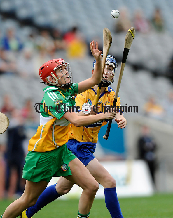 Offaly's Aoife Kelly and Clare's Carina Roseingrave contest a ball during the All-Ireland junior camogie final at Croke Park. Photograph by John Kelly.