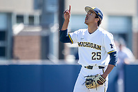 Michigan Wolverines pitcher Isaiah Paige (25) celebrates the end of the NCAA baseball game against the Illinois Fighting Illini on March 20, 2021 at Fisher Stadium in Ann Arbor, Michigan. Michigan won the game 8-1. (Andrew Woolley/Four Seam Images)