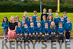 Mairead O'Connor with her junior infants class on their first day of school in Holy Family NS Rathmore on Monday