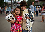 OCEANPORT, NJ - JUL 30: Siblings pose with their stuffed horses on Fourstardave Stakes Day at Saratoga Race Course on August 12, 2017 in Saratoga Springs, New York (Photo by Scott Serio/Eclipse Sportswire/Getty Images)