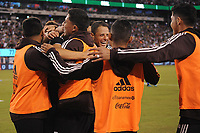 EAST RUTHERFORD, NJ - SEPTEMBER 6: Erick Gutierrez #25 of Mexico celebrates his score with team mates during a game between Mexico and USMNT at MetLife Stadium on September 6, 2019 in East Rutherford, New Jersey.