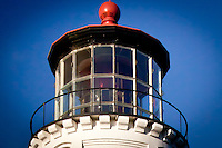A close-up view of the light atop the Umpqua River Lighthouse whose signal is two white flashes followed by one red.  It is the only lighthouse on the Oregon coast with a colored light.