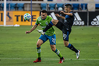 SAN JOSE, CA - OCTOBER 18: Shane O'Neill #27 of the Seattle Sounders and Cristian Espinoza #10 of the San Jose Earthquakes battle for the ball during a game between Seattle Sounders FC and San Jose Earthquakes at Earthquakes Stadium on October 18, 2020 in San Jose, California.