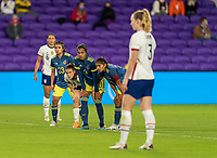 ORLANDO, FL - JANUARY 18: Kelley O'Hara #5 watches Samantha Mewis #3 of the USWNT as she takes a penalty kick during a game between Colombia and USWNT at Exploria Stadium on January 18, 2021 in Orlando, Florida.