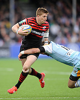 20130512 Copyright onEdition 2013©.Free for editorial use image, please credit: onEdition..David Strettle of Saracens is tackled by Stephen Myler of Northampton Saints during the Premiership Rugby semi final match between Saracens and Northampton Saints at Allianz Park on Sunday 12th May 2013 (Photo by Rob Munro)..For press contacts contact: Sam Feasey at brandRapport on M: +44 (0)7717 757114 E: SFeasey@brand-rapport.com..If you require a higher resolution image or you have any other onEdition photographic enquiries, please contact onEdition on 0845 900 2 900 or email info@onEdition.com.This image is copyright onEdition 2013©..This image has been supplied by onEdition and must be credited onEdition. The author is asserting his full Moral rights in relation to the publication of this image. Rights for onward transmission of any image or file is not granted or implied. Changing or deleting Copyright information is illegal as specified in the Copyright, Design and Patents Act 1988. If you are in any way unsure of your right to publish this image please contact onEdition on 0845 900 2 900 or email info@onEdition.com