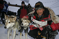 Third place finisher Mitch Seavey with his lead dogs at the finish line in Nome.  End of the  2005 Iditarod Trail Sled Dog Race.