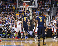 March 21st, 2013: California's Robert Thurman dunks the ball during a game against UNLV at HP Pavilion, San Jose, California. California defeated UNLV 64 - 61