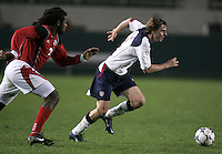 USA's Eddie Gaven, dribbles the ball away from a Trinidad defender during a USA 6-1 victory over Trinidad, in Carson, Calif., Wednesday Jan. 12, 2004. Gaven scored a hat trick during the match, during the opening round of the Under-20 CONCACAF qualification for the FIFA world championships.
