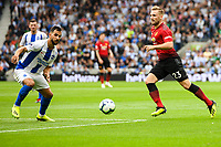 Luke Shaw of Manchester United (23) In action  during the Premier League match between Brighton and Hove Albion and Manchester United at the American Express Community Stadium, Brighton and Hove, England on 19 August 2018. Photo by Edward Thomas / PRiME Media Images.