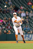 Texas Longhorns third baseman Andy McGuire #5 makes a throw to first base against the Rice Owls at Minute Maid Park on February 28, 2014 in Houston, Texas.  The Longhorns defeated the Owls 2-0.  (Brian Westerholt/Four Seam Images)