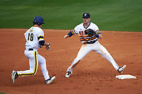 Canisius College Golden Griffins shortstop Anthony Massicci (7) waits for a throw as Jake Bivens (18) gets back to second base during the first game of a doubleheader against the Michigan Wolverines on February 20, 2016 at Tradition Field in St. Lucie, Florida.  Michigan defeated Canisius 6-2.  (Mike Janes/Four Seam Images)