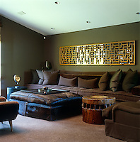 In this living room various textures in leather, wool and wood have been brought together to create an intimate and inviting space