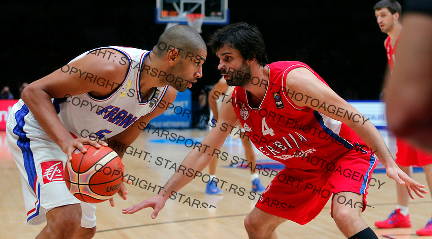 France's Nicolas Batum (L) vies with Serbia's Milos Teodosic (R) during European championship basketball match for third place between France and Serbia on September 20, 2015 in Lille, France  (credit image & photo: Pedja Milosavljevic / STARSPORT)