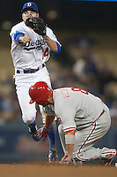 08/9/11 Los Angeles, CA:Los Angeles Dodgers shortstop Jamey Carroll #14 during an MLB game against the Philadelphia Phillies played at Dodger Stadium. The Phillies defeated the Dodgers 2-1.