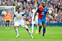 Sun 22 September 2013<br /> <br /> Pictured: Angel Rangel of Swansea and Adlene Guedioura of Crystal Palace<br /> <br /> Re: Barclays Premier League Crystal Palace FC  v Swansea City FC  at Selhurst Park, London