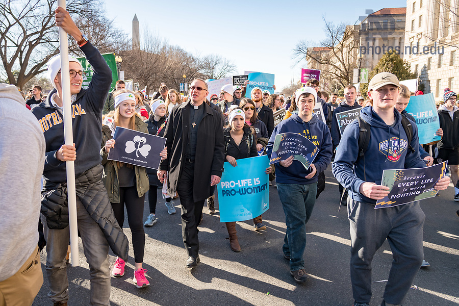 January 19, 2018; Rev. Kevin Sandberg, C.S.C. walks with students at the March for Life in Washington D.C. (Photo by Matt Cashore/University of Notre Dame)