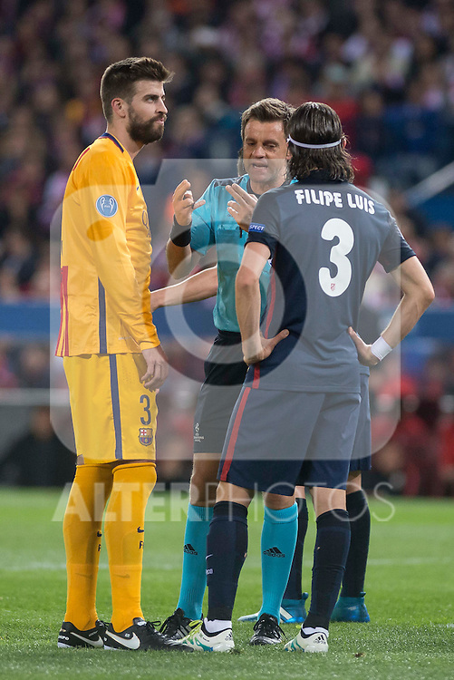 Atletico de Madrid's Gerard Pique and FC Barcelona Filipe Luis during Champions League 2015/2016 Quarter-Finals 2nd leg match. April 13, 2016. (ALTERPHOTOS/BorjaB.Hojas)