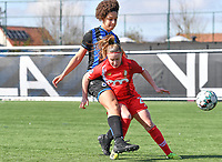 Davinia Vanmechelen (25) of Standard  pictured in a duel with Tracy Furo (14) of Club Brugge during a female soccer game between Club Brugge Dames YLA and Standard Femina de Liege on the 17 th matchday of the 2020 - 2021 season of Belgian Scooore Womens Super League , saturday 20 March 2021  in Brugge , Belgium . PHOTO SPORTPIX.BE   SPP   DAVID CATRY