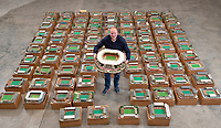 BNPS.co.uk (01202 558833)<br /> Pic: Zachary Culpin/BNPS<br /> <br /> Pictured: Adam Gascoigne of Graham Budd Auctions with Wembley stadium<br /> <br /> An incredible collection of model football stadiums handmade by a soccer fan have sold for almost £19,000 after being found in a storage unit.<br /> <br /> Model-maker John Le Maitre created miniature versions of all 92 English Football League club grounds from the 1980s, as well as the old Wembley Stadium.<br /> <br /> They featured on a Blue Peter episode that year and are a throwback to a bygone age when football grounds with their banks of terraces looked very different to today's super stadiums.