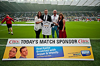 Saturday 17 August 2013<br /> <br /> Pictured: Match Ball sponsors with Lee Trundle<br /> <br /> Re: Barclays Premier League Swansea City v Manchester United at the Liberty Stadium, Swansea, Wales