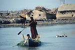 Marsh Arabs. Southern Iraq.  Children and mother in boats. Haur al Mamar or Haur al-Hamar marsh collectively known now as Hammar marshes Iraq 1984