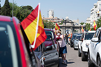 MADRID, SPAIN - MAY 23: A woman gets out from her car during the demonstration organized by VOX, Spanish far-right party and third biggest party in the Parliament, to demand the resign of the national Government on 23 May 2020, in Madrid, Spain. This protest, which should be participated from the car, occurs in the middle of deescalation plans of covid 19 and the state of emergency remains active due to the coronavirus. (Photo by Sergio Belena / VIEWpress).