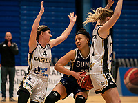Catherine Carr of Sevenoaks Suns is blocked by Maddy McVicar of Newcastle Eagles and Yemisi Mefful of Newcastle Eagles during the WBBL Championship match between Sevenoaks Suns and Newcastle Eagles at Surrey Sports Park, Guildford, England on 20 March 2021. Photo by Liam McAvoy