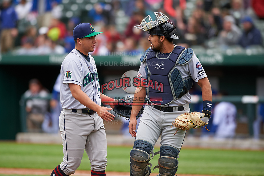 Cedar Rapids Kernels Andrew Cabezas (21) and David Banuelos (15) walk off the field between innings of a Midwest League game against the South Bend Cubs at Four Winds Field on May 8, 2019 in South Bend, Indiana. South Bend defeated Cedar Rapids 2-1. (Zachary Lucy/Four Seam Images)