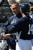 February 25, 2010:  Shortstop Derek Jeter of the New York Yankees talks to Curtis Granderson during practice at Legends Field in Tampa, FL.  Photo By Mike Janes/Four Seam Images