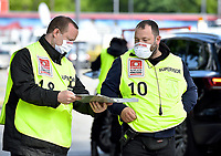 17th May 2020,Stadion An der Alten Försterei, Berlin, Germany; Bundesliga football, FC Union Berlin versus Bayern Munich; Two Supervisor with protective mask discuss plans