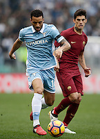Calcio, Serie A: Lazio vs Roma. Roma, stadio Olimpico, 4 dicembre 2016.<br /> Lazio's Felipe Anderson, left, is chased by Roma's Diego Perotti during the Italian Serie A football match between Lazio and Rome at Rome's Olympic stadium, 4 December 2016. Roma won 2-0.<br /> UPDATE IMAGES PRESS/Isabella Bonotto