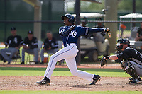 Cristian Heredia (44) of the San Diego Padres follows through on his swing during an Instructional League game against the Chicago White Sox on September 26, 2017 at Camelback Ranch in Glendale, Arizona. (Zachary Lucy/Four Seam Images)