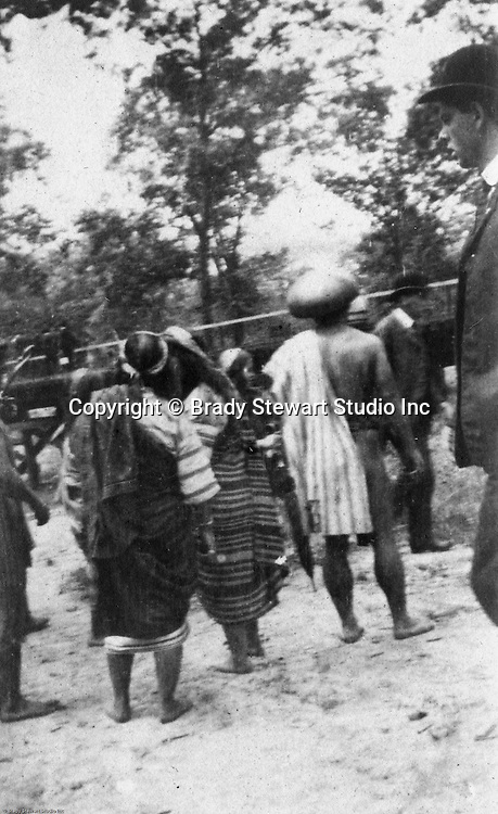 St Louis MO:  View of an Igorot family inside the Philippine Village at the Louisiana Purchase Exposition.  The Philippine Village was one of the most popular exhibits at the Fair.