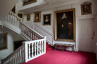 A portrait of Mary Queen of Scots dominates the staircase landing