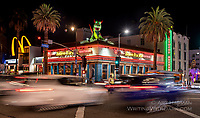 Hollywood Ripley's at Night by Art Harman. Two cars passed, with an officer directing traffic, and a dragon standing guard on the roof!