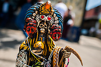 A statue of Santa Muerte (Holy Death), having the Aztec culture features, is seen placed on the street during the religious ceremony in Tepito, Mexico City, Mexico, 1 April 2018. The religious cult of Santa Muerte is a fusion of Aztec death worship rituals and Catholic beliefs. Born in lower-class neighborhoods of Mexico City, it has always been closely associated with crime. In the past decades, original Santa Muerte followers, such as prostitutes, pickpockets and street drug traffickers, have merged with thousands of ordinary Mexican Catholics. The Holy Death veneration, offering a spiritual way out of hardship in modern society, rapidly expanded. Although the Catholic Church still considers Santa Muerte followers the devil worshippers, on the first day of every month, crowds of Santa Muerte believers fill the streets of Tepito. Holding statues of Holy Death clothed in a long robe, they pray for healing, protection, money or any other favor in life.