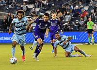 KANSAS CITY, KS - APRIL 23: Gianluca Busio #10 of Sporting Kansas City attempts to get away from Kyle Smith #24 of Orlando City SC during a game between Orlando City SC and Sporting Kansas City at Children's Mercy Park on April 23, 2021 in Kansas City, Kansas.