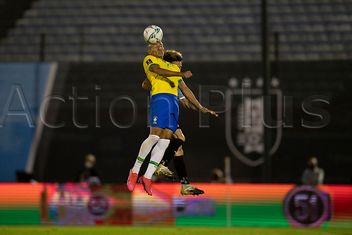 17th November 2020; Centenario Stadium, Montevideo, Uruguay; Fifa World Cup 2022 Qualifying football; Uruguay versus Brazil; Nahitan Nández of Uruguay and Richarlison of Brazil challenge for a header