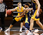 SIOUX FALLS, SD - MARCH 7: Sam Griesel #5 of the North Dakota State Bison backs down Brandon McKissic #3 of the UMKC Kangaroos during the Summit League Basketball Tournament at the Sanford Pentagon in Sioux Falls, SD. (Photo by Richard Carlson/Inertia)